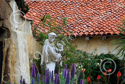 SMRSTY 00014 A Franciscan priest holding an infant, at Mission Carmel, by Peter J Mancus