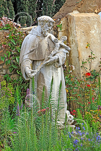 SMRSTY 00017 A Franciscan priest holding a crucifex, at Mission Carmel, by Peter J Mancus