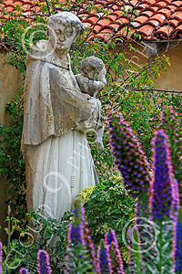 SMRSTY 00011 A Franciscan priest holding an infant, at Mission Carmel, by Peter J Mancus