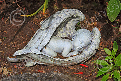 SMRSTY 00010 An infant sleeping inside angel's wings, at Mission Carmel, by Peter J Mancus