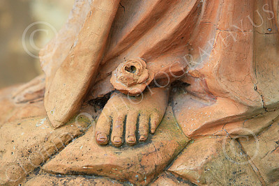 SMRSTY 00060 A rose on the Virgin Mary's foot, at Spanish Mission Carmel, by Peter J Mancus