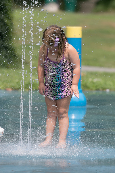 The Crocker Playground water spray park in Fitchburg was a good way for kids to have fun as they tried to stay cool on Wednesday. Playing in the water is Schayleigh Young, 3, from Barre. SENTINEL & ENTERPRISE/JOHN LOVE