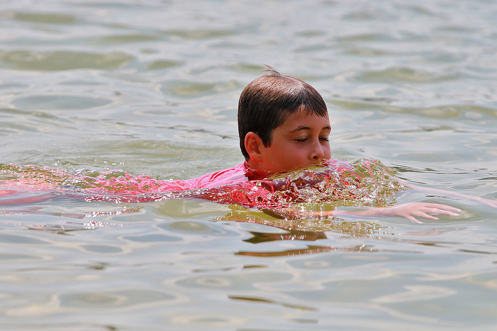 . Lunenburg Town Beach at Lake Whalom was just right on Tuesday for residence to stay cool in the 90 degree heat. Staying cool by swimming in the lake is Owen Synder, 9, of Lunenburg. SENTINEL& ENTERPRISE/JOHN LOVE