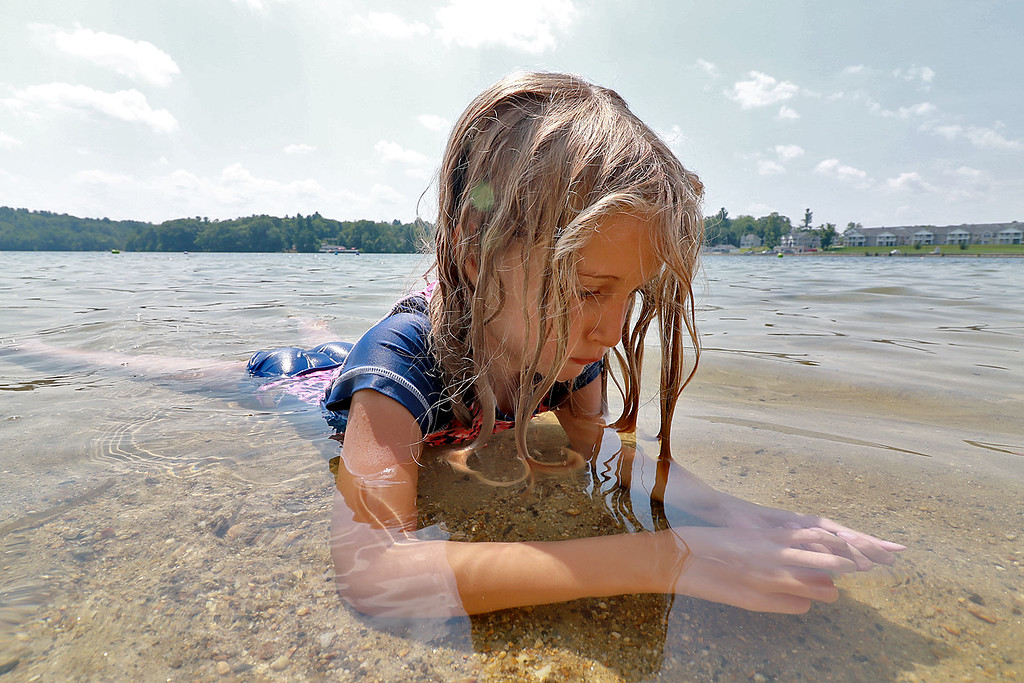 . Lunenburg Town Beach at Lake Whalom was just right on Tuesday for residence to stay cool in the 90 degree heat. Playing with the sand shallow water of the lake was Hope Synder, 5, of Lunenburg. SENTINEL& ENTERPRISE/JOHN LOVE