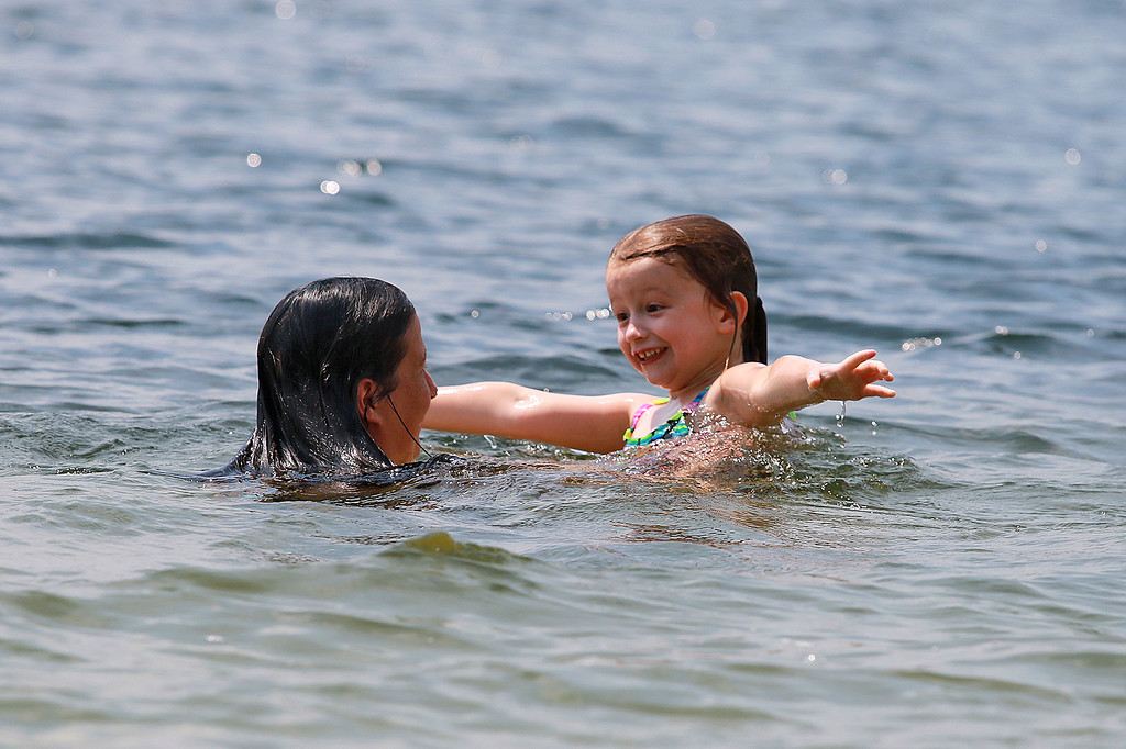 . Lunenburg Town Beach at Lake Whalom was just right on Tuesday for residence to stay cool in the 90 degree heat. Kiara Cicone, 5, of Lunenburg has fun in the water with her mom Krystal Morini. SENTINEL& ENTERPRISE/JOHN LOVE