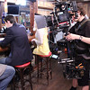 Short Film Shoot with HVX200: Steadicam : November 12, 2009. A short film shoot at a bar in Chicago with a fully loaded Panasonic HVX200. Director: Evan Senger. Cinematography: Brent Yontz. Steadicam Operation: Carl Wiedemann. Photos shot by second AC Camrin Petramale. This sequence shows us working out two reverse tracking shots.