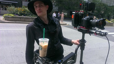 July 10, 2013. Taking a coffee break on Michigan Ave. on a promotional video shoot for the Magnificent Mile Association. Working with a Canon 7D on my Steadicam Flyer LE.