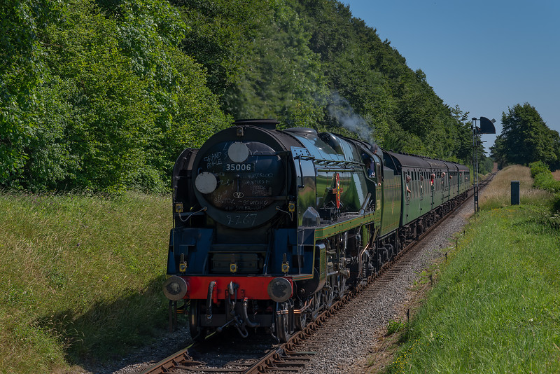"""35006 """"Peninsular & Oriental SN Co"""" passes the Ropley Down Outer Home signal <br /> with the 10:05 Alton - Alresford, on 9th July 2017."""