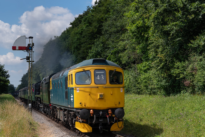 """33053 and 35006 """"Peninsular & Oriental SN Co"""" at Milepost 56 <br /> with the 11:00 Alresford - Alton, on 9th July 2017."""