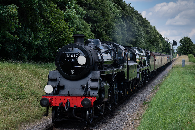 """Std 4 No. 76017 and 35006 """"Peninsular & Oriental SN Co"""" with load 8, approaching Ropley with the 14:20 Alton - Alresford, non-stop special working, on 9th July 2017."""