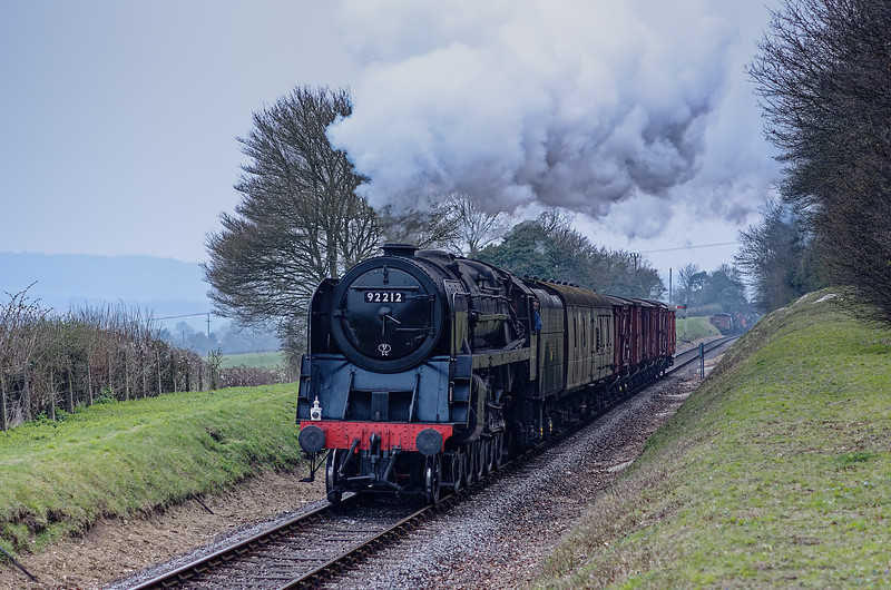 9F 92212 climbing away from Ropley with the 16:30 Alresford - Alton Vans, <br /> on 26th March 2011.