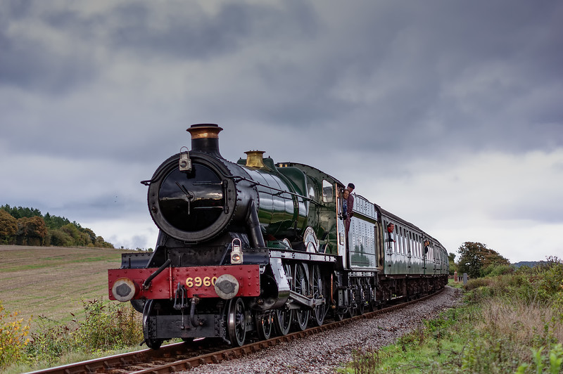 6960 approaches Northside Crossing, with the 16:10 Alton - Alresford, on 24th October 2014.