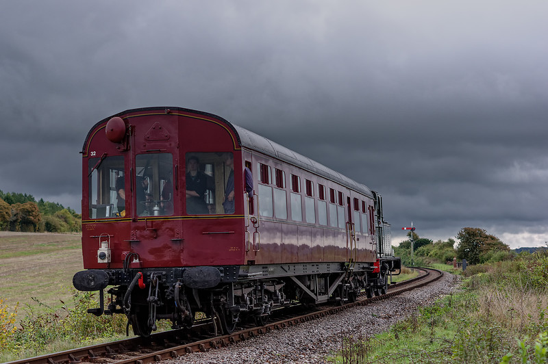 Autocoach W231 and 1450 approach Northside Crossing with the 16:18 Ropley - Alresford, on 24th October 2014.