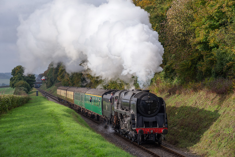 9F No. 92212 passes the Ropley Down Outer Home signal with the 09:30 Alresford - Alton, <br /> on 21st October 2016.