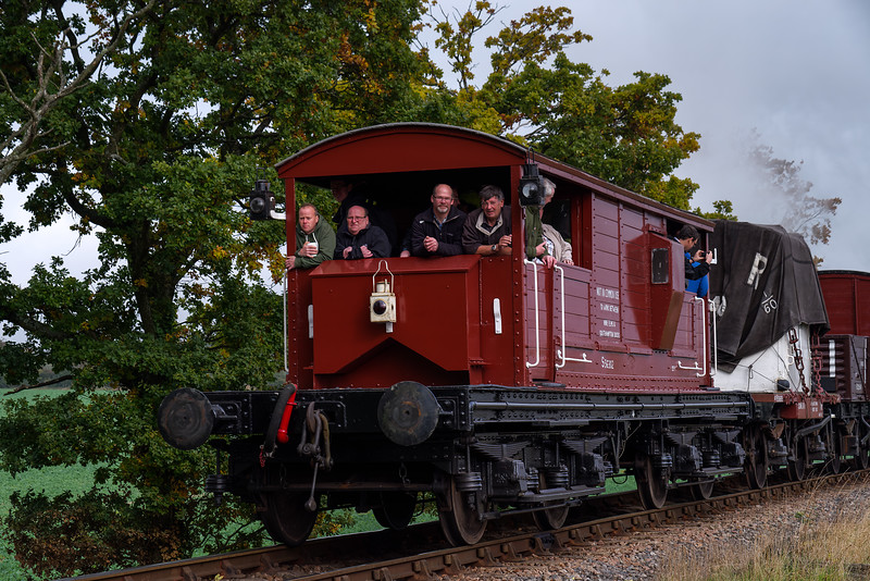 The Queen Mary Brake Van, S56302, plus paying passengers, <br /> at the rear of the 11:58 Alresford Sidings - Alton Freight, on 22nd October 2016.