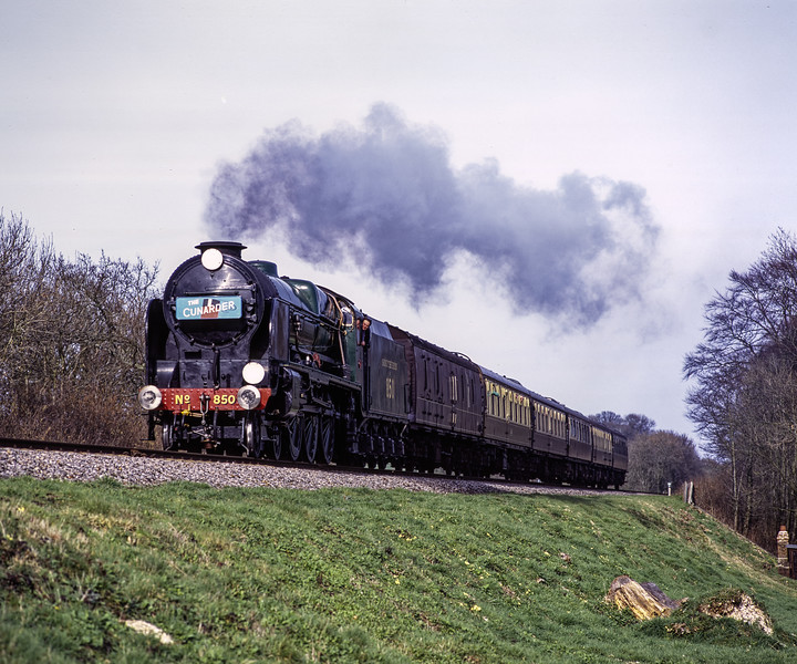"""850 """"Lord Nelson"""" at Stable Lane, with the 14:01 Alton - Alresford, on 15th March 2009.  Scanned Transparency."""