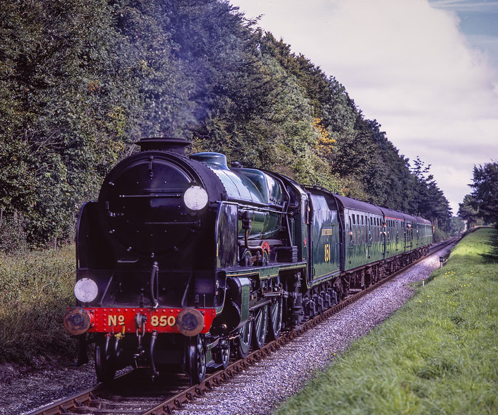"""850 """"Lord Nelson"""" passes Milepost 56, with the 10:51 Alton - Alresford, <br /> on 12th September 2009. Scanned Transparency."""