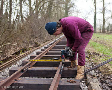 Drilling holes for the pins that will secure the rail