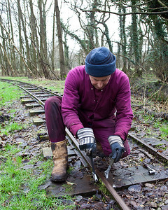 Unbolting the fish plates to remove the old rail