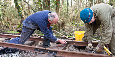 Applying grease to the rails before the fish plates are bolted in place