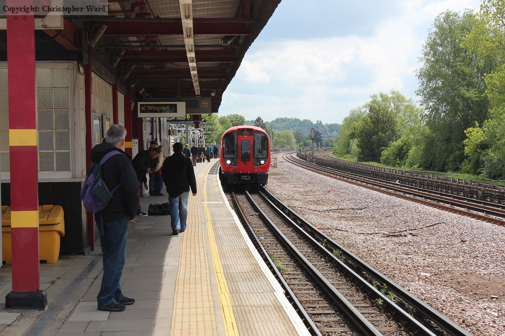 A train of modern S Stock on an Uxbridge working draws into the station
