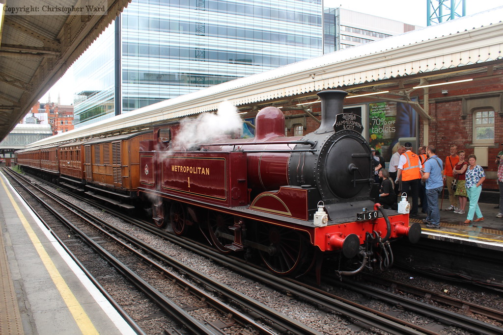 The old fashioned consist looking at home among the older charm of the old Metropolitan station at Hammersmith
