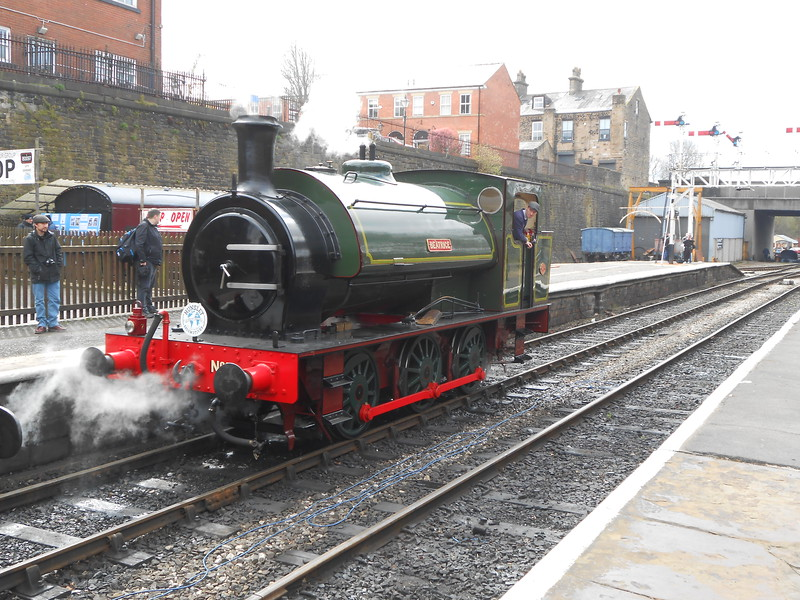 """0-6-0 Saddle Tank <br /> <br /> Saddle Tank means: <br /> <br /> That the water tank on the Loco looks like a horse saddle because it <br /> <br /> sits over the top of the Boiler <br /> <br /> name of Loco <br /> <br /> Beatrice <br /> <br /> Built 1945 <br /> <br /> Beatrice comming off it's train at Bury after arriving in on a service <br /> <br /> from Ramsbottom <br /> <br /> History of Beatrice below <br /> <br /> Beatrice, built 1945 under an order for two locomotives for the <br /> <br /> Ministry of Supply. Works number 2705 Beatrice, and 2704<br /> <br />  (fate unknown). 2705 was delivered to The Ackton Hall Colliery Co. <br /> <br /> at Featherstone near Pontefract, named after colliery manager's <br /> <br /> daughter. Because coal industry nationalisation was expected the <br /> <br /> company kept the loco in ex-works condition, steaming it once per <br /> <br /> month in order to claim maximum compensation for new plant.<br /> <br /> Beatrice was given a major overhaul at the Hunslet works in 1964, <br /> <br /> also fitted with the """"gas producer"""" system including an underfeed <br /> <br /> stoker. The loco was returned to Ackton Hall with a new NCB South <br /> <br /> Yorkshire Area livery of dark red rather than the original green, and <br /> <br /> now numbered S119 in the NCB fleet.<br /> <br /> Sold into preservation in 1976, Operating from 1982 the loco has <br /> <br /> been at the Embsay and Bolton Abbey Steam Railway for longer <br /> <br /> than her previous industrial career. Overhauled again and back at <br /> <br /> work in 2012, Beatrice has the upgrades of a rocking grate, hopper <br /> <br /> ashpan and a Lempor exhaust system."""