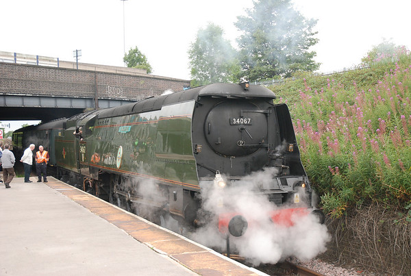 Tangmere stands in the platform while taking water and it steams away