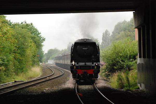 Tangmere enters the road over bridge and heads into Denton station