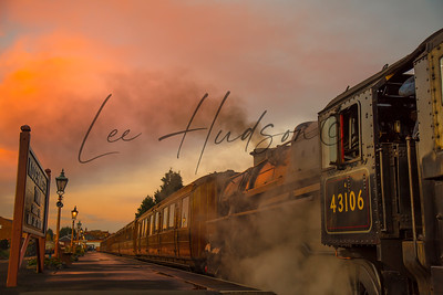 Steam train at sunset