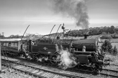 Vintage steam train leaving Highley