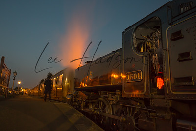 Steam locomotive at dusk