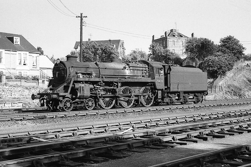 August 1964:   BR Standard Claas 5 73070  is running from the sheds to the  station at Weymouth.  The picure was taken from the bottom of the original footbridge.