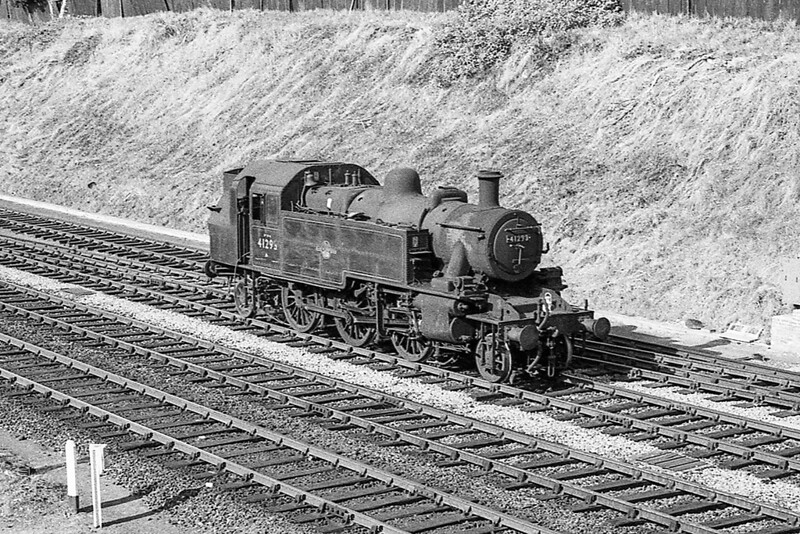 August 1964:  Trotting back to the sheds at Weymouth is Micky Mouse tank 41295.  This is the frst time that I have ever seen this  picturee other than as a negative.  To my surprise it is sporting a bell on the front of the cab.  A bell was requred when it was used on the quay line. and I have pictures of 7780 and 7782 st WEymouth both fitted with a bell. on the running plate.
