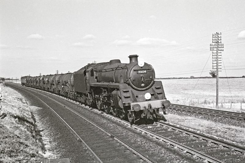Aug 64: BR Standard 73114 takes the Salisbury line with empty Milk tanks