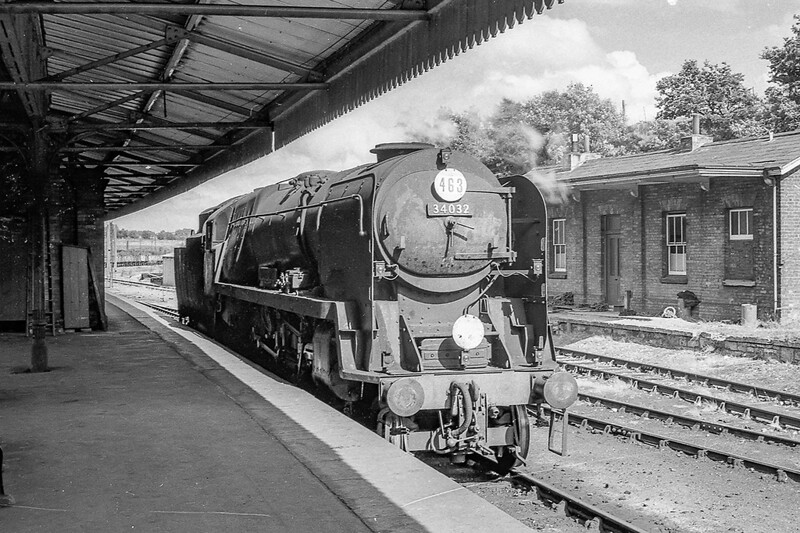 28th Aug 1964:  Quietly simmering round the back at Yeovil Junction is 34032 'Camelford'.  There was no crew on board so I suspect that it was there aaiting it's next turn  or as a standbye in case there was a failure..