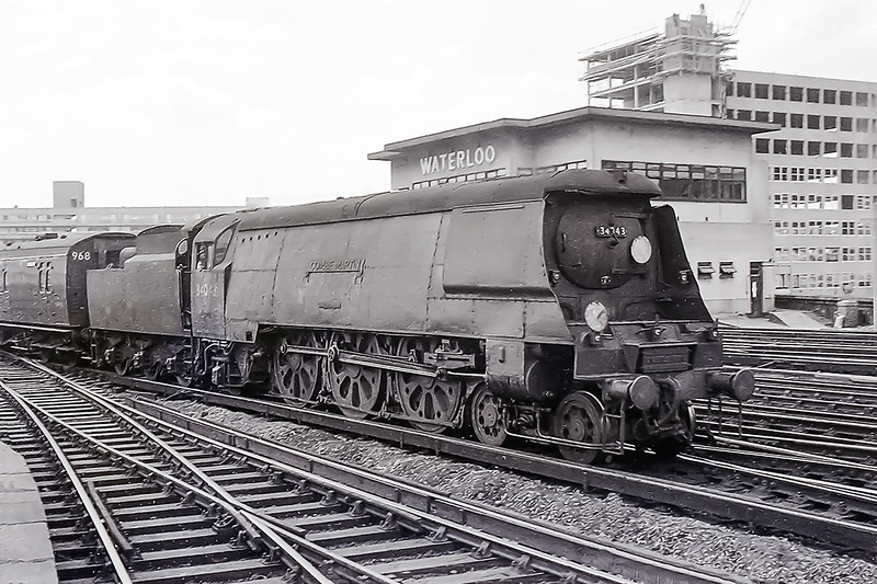January 1962;  Arriving ar Waterloo with a train from the Weymouth Line is a very dirty 34043 'Combe Martin'