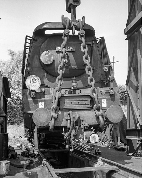 August 1963:  With the Bogie and leading drivers removed 34049 'Anti Aircraft Comand' is being suspended under the gallows while repairs to the axle boxes are undertaken.