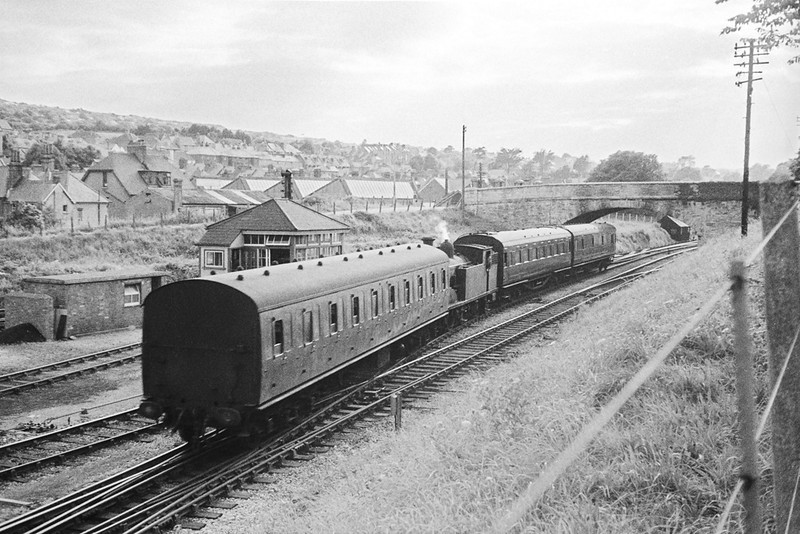 An M7 30056 has collected an additional coach from the siding and is shunting back into the platform at Swanage