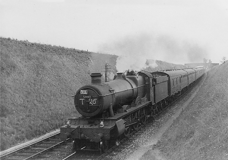 5992 'Horton Hall' dropping down through Upton Scudamore towards Westbury