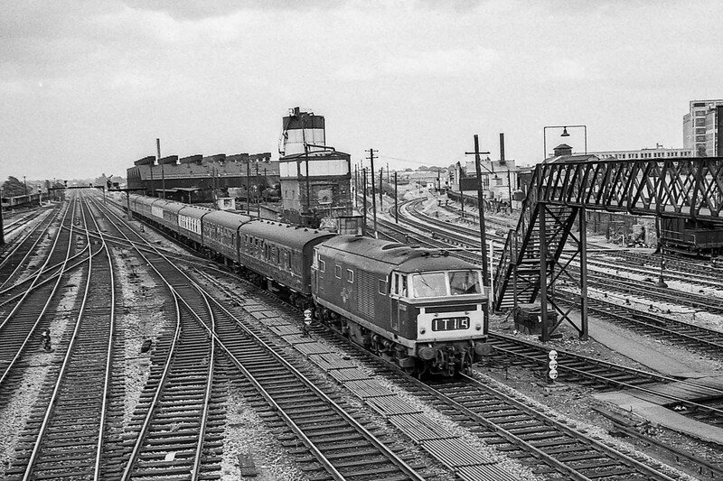 June 1964L.  A BR Class 35 Hymek is racing West through Southall with an afternoon passenger service.  Regretably I did not record the number.