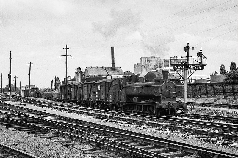 July 1964:   4608 is at the top of the climb from Brentord as it arrives at Southall with a freight train.