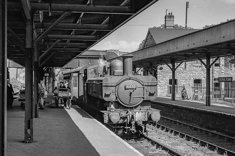 28th Aug 1964:  The way it. was, 6430 is working the Yeovil Junction to Yeovil Town shuttle.  Having just arrived at the Town the porter is  helping passengers with their luggage etc