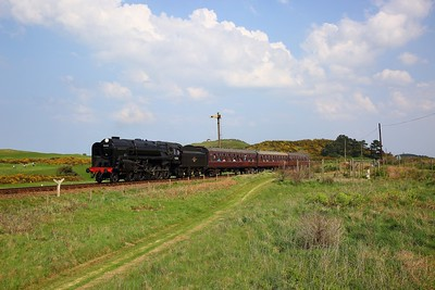 Standard Class 9F No  92203 hauls the 1429 Sheringham to Holt at Sheringham Golf course on the 22nd April 2018