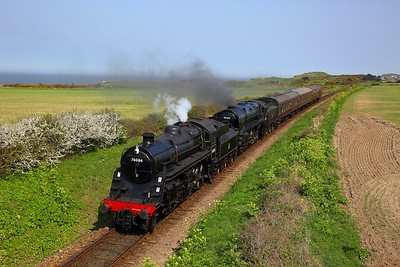 Standard Class 4 No  76084 leads Standard Class 9F No  92203 on the 1429 Sheringham to Holt at Dead Man's Bridge on the 21st April 2018 1