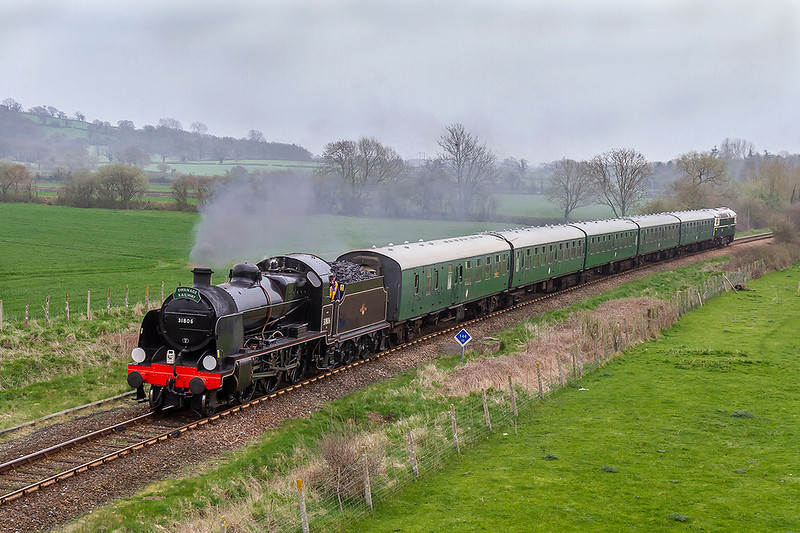 13th Apr 2018:  The 13th of April is an inportant day in the life of Class U 2-6-0 31806 from the Swanage Raiway as it is out on the main line on a test run.  With Crompton D6515 (33012) dead at the rear 5Z42 from Swanage to Yeovil Junction is pictured at Thornford.