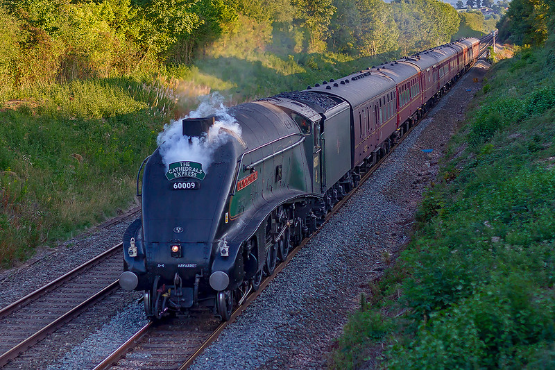21st Nov 1812:  1Z94 is the return working of the 'Cathedrals Express' from Minehead to Victoria.  LNER A4 Pacific 60009 'Union of South Africa' is going well and sounding good as it races up the grade on the Frome Avoider. I would have prefered if  the chime whistle had not soundedat just the wrong moment nice sound that it may be.