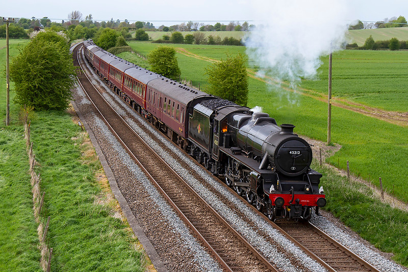 2nd May 2018:  On it's way back to Victoria with the Cathedrals Express from Bristol Temple Meads is LMS Black 5 4-6-0 45212.  Having just climbed the steep grade to Upton Scudamore 1Z84 is pictured from the bridge on the Warminster By-Pass.
