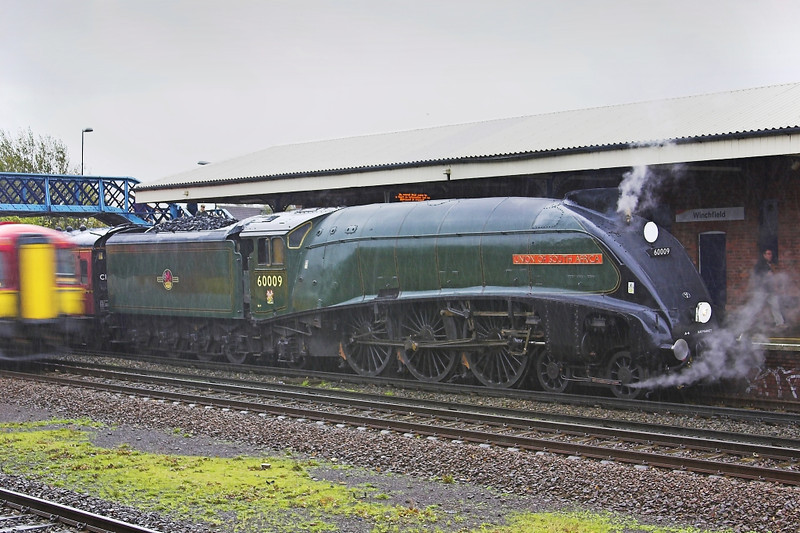 6th Nov 05:  60009 Union of South Africa, 1Z96, 08:27 Clapham Junction - Exeter.  Stopped to take water in torrential rain.  Winchfield