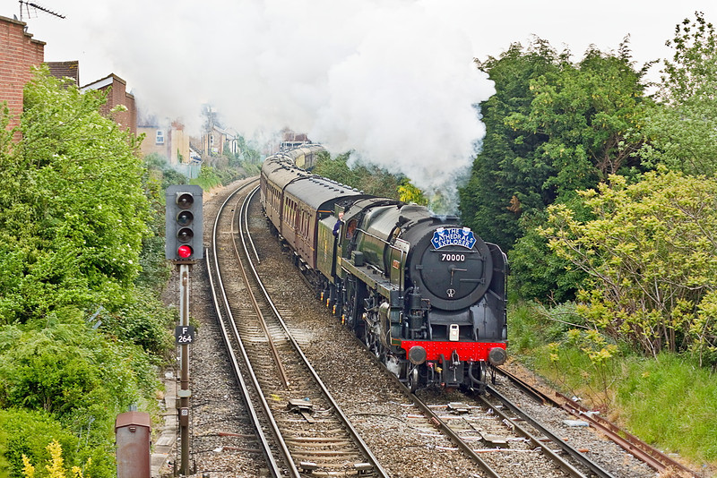 18th May 12:  70000 'Britannia' on the first leg of The Cathedrals Explorer excursion from Staines to Victoria via Tonbridge hammes away from Egham.  This is the start of an eight day tour of the country which will today end at Durham behind 60163 Tornado